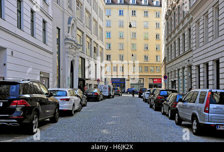 VIENNA, AUSTRIA - JUNE 6: Cars parking in the street in downtown of Vienna on June 6, 2016. Vienna is a capital - Stock Photo