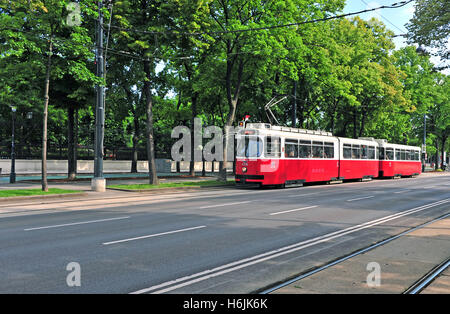 VIENNA, AUSTRIA - JUNE 6: Red classic tram goes by Ringstrasse street, Vienna on June 6, 2016. Vienna is a capital and largest c