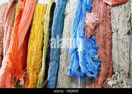 Weaving mill for silk carpets in Samarkand, Uzbekistan. Weverij voor zijden vloerkleden in Samarkand, Oezbekistan. - Stock Photo