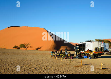 Dune 45 with safari tourists at Namib-Naukluft National Park in the Namib Desert, Namibia - Stock Photo