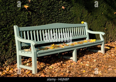 Park bench in the palace gardens, Schloss Benrath castle, Duesseldorf, capital city of North Rhine-Westphalia - Stock Photo