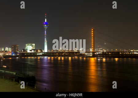 City gate, Rheinturm tower and Rheinkniebruecke bridge at night, state capitol Duesseldorf, North Rhine-Westphalia - Stock Photo
