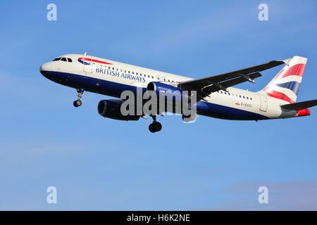 British Airways Airbus A320-200 G-EUYI landing at London Heathrow Airport, UK - Stock Photo