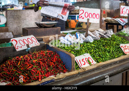 Red and green chillies on sale at Central Market, Port Luis, Mauritius, Africa - Stock Photo