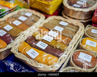 Variety of spice packets on sale in packaged baskets in Central Market, Port Luis, Mauritius, Africa - Stock Photo