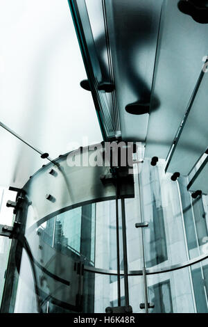 People seen climbing a glass spiral staircase in the flagship Apple Store in Central Park, New York City. - Stock Photo