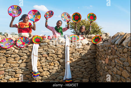 Axum, Ethiopia - January 20 , 2016:, Joung craft vendors between the ruins of the baths of the Queen of Saba - Stock Photo