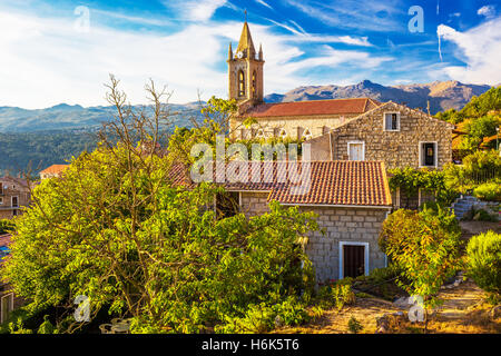 Church in Zonza village with typical stone houses during sunset, Corsica island, France, Europe - Stock Photo