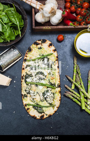 asparagus and chicken green pizza on wood fired thin crust - Stock Photo