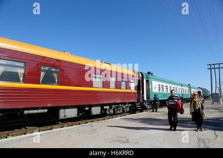 Kamashi train station, Uzbekistan. Treinstation Kamashi, Oezbekistan. The Orient Silk Road Express is waiting. - Stock Photo