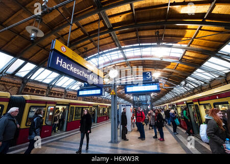 Platform and S-Bahn trains at Hackescher Markt railway station in Berlin Germany - Stock Photo