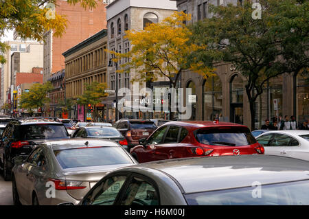 Traffic congestion on Rue Sainte-Catherine or Saint Catherine Street in downtown Montreal, Quebec, Canada - Stock Photo