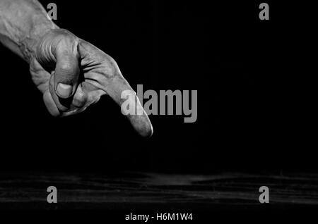 Dirty hand pointing a finger at something. - Stock Photo
