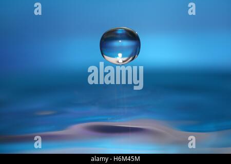 blue macro close-up macro admission close up view water drop drip drops seeping sopping drips bowl marek water - Stock Photo