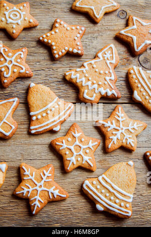 Christmas gingerbread cookies on wooden table - Christmas homemade festive bakery - Stock Photo