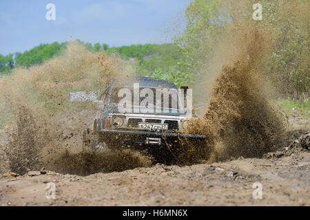 cars moving on the off road at competitions - Stock Photo
