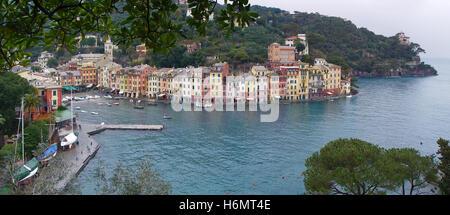 Sea dock and colored houses in beautiful Italian town Portofino. - Stock Photo