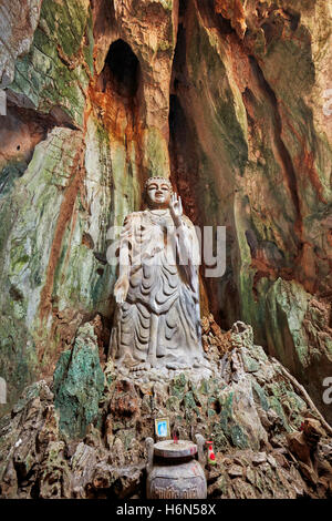 The Upright Buddha statue in Tang Chon Cave. Thuy Son Mountain, The Marble Mountains, Da Nang, Vietnam. - Stock Photo