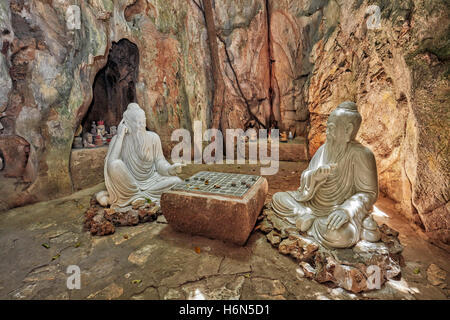Two wise men playing Xiangqi (Chinese chess) – sculpture in Ban Co (Chess Board) Grotto in Tang Chon Cave. The Marble - Stock Photo
