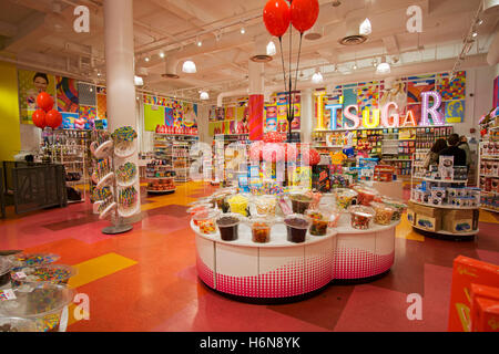 An interior wide view of It'Sugar, a candy by the pound chain store, this one being on Broadway in Greenwich Village. - Stock Photo