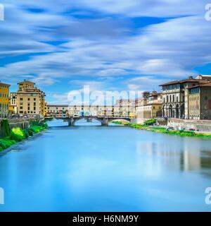 Ponte Vecchio on sunset, old bridge, medieval landmark on Arno river. Florence, Tuscany, Italy. Long exposure photography. - Stock Photo