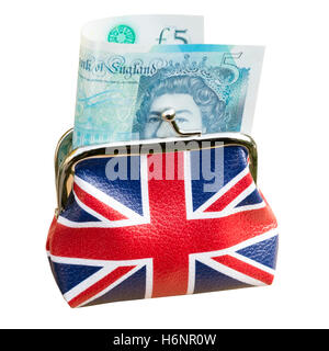 Union jack money purse with new five pound note sterling, UK. Cut out or isolated on a white background. - Stock Photo
