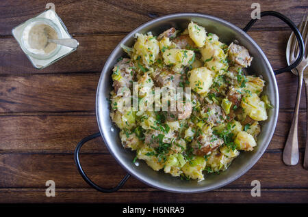 Sausage and leek hash with horseradish sauce - Stock Photo