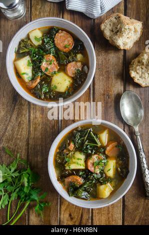 Kale, potato and chorizo soup - Stock Photo