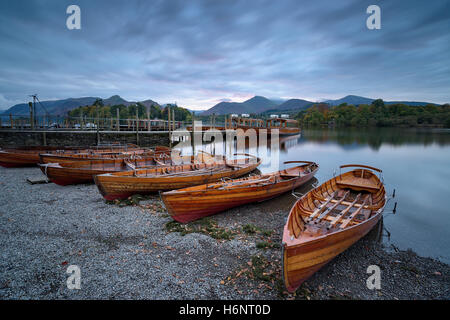 Boats on the shore of Derwentwater at Keswick in the Lake District National Park in Cumbria - Stock Photo