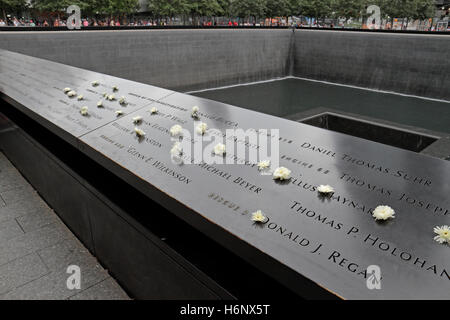 Detail showing some of the victiims' names on the edge of the National September 11 Memorial, Manhattan, New York, - Stock Photo