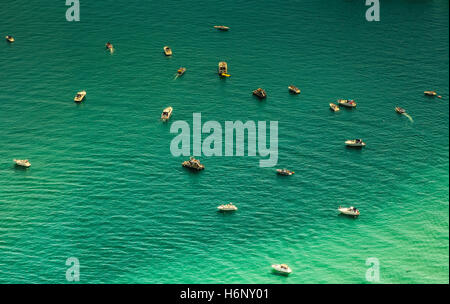 Aerial view of scattered fishing boats in turquoise colored water of Chicago river - Stock Photo