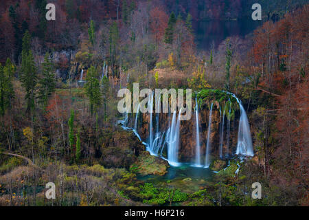 Plitvice Waterfall in autumn. Image of waterfall located in Plitvice national park, Croatia during autumn dawn. - Stock Photo