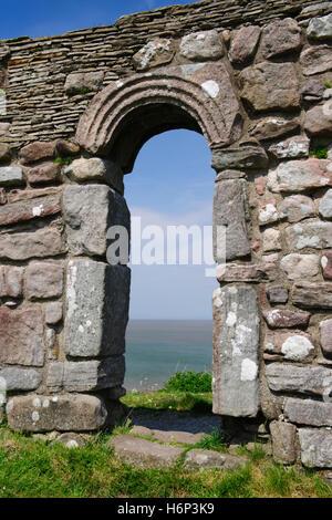 St Patrick's Chapel, Heysham, overlooking Morecambe Bay, Lancashire: S doorway, C8th Anglo-Saxon with upright jamb - Stock Photo