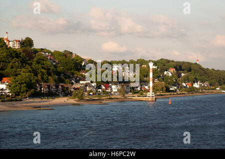 city town germany german federal republic hamburg elbe lighthouse river water humans human beings people folk persons - Stock Photo