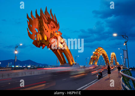 Dragon Bridge (Cau Rong) over the River Han illuminated at dusk. Da Nang city, Vietnam. - Stock Photo