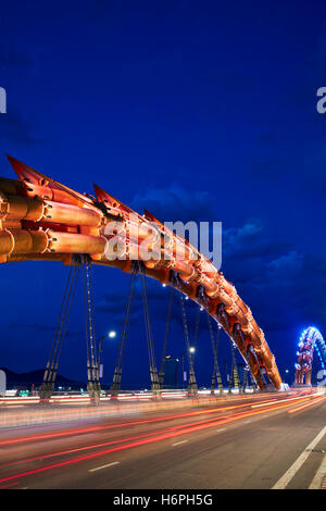 Dragon Bridge (Cau Rong) over the River Han at dusk. Da Nang city, Vietnam. - Stock Photo