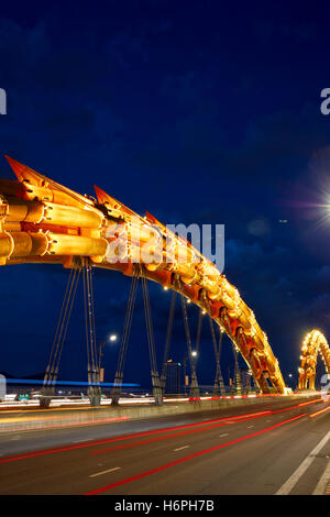 Dragon Bridge (Cau Rong) over the River Han at dusk. Da Nang city, Vietnam. - Stock Photo