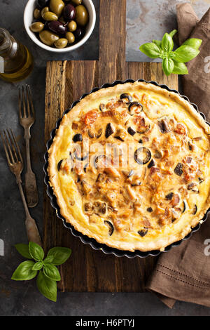 Quiche with eggplant, chicken and olives Stock Photo