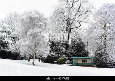 Snow-covered trees and a shelter in Waterlow Park, North London, UK - Stock Photo