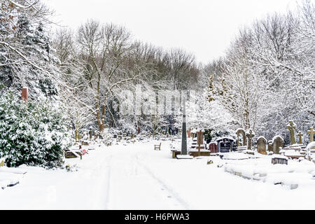Highgate Cemetery in the snow, seen from Swain's Lane, London, UK - Stock Photo