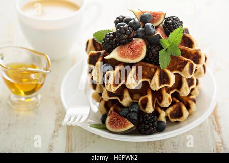 Fluffy breakfast waffles with fresh fruits - Stock Photo