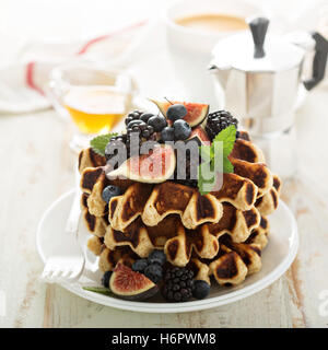 Fluffy breakfast waffles with fresh fruits - Stock Photo