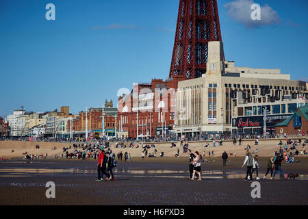 Blackpool busy crowded beach sunny day    Holiday  resort Lancashire tourist attractions sea front attraction Tourists - Stock Photo
