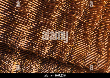 Abstract industrial background with stack of rusted reinforcing mesh elements, photo with selective focus - Stock Photo