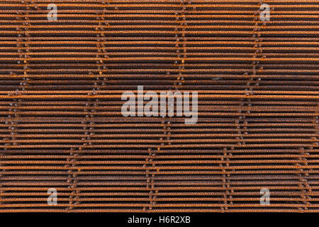Abstract industrial background, stack of rusted reinforcing mesh elements - Stock Photo