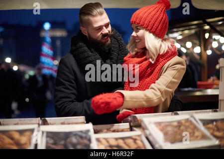 Night time to buy some sweets - Stock Photo