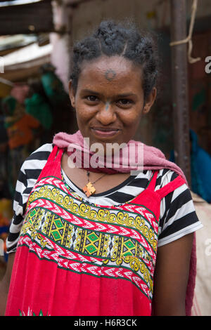 Young girl with a traditional cross tattoo on her nose in the market at Dire Dawa, Ethiopia - Stock Photo