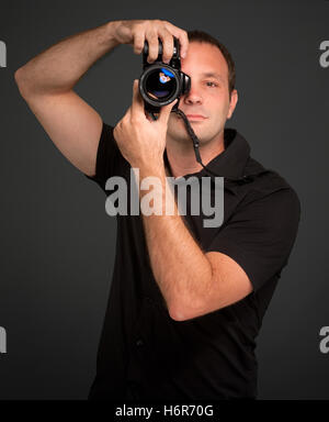 portrait black swarthy jetblack deep black blank european caucasian photo camera studio adult lens photographer - Stock Photo