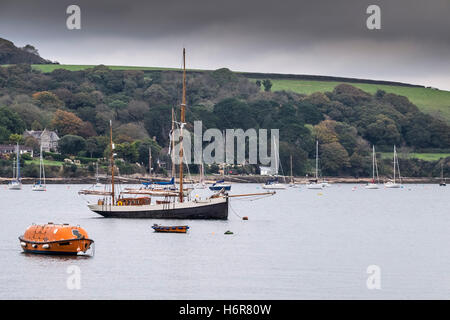 Various boats moored in Carrick Roads in Falmouth, Cornwall. - Stock Photo