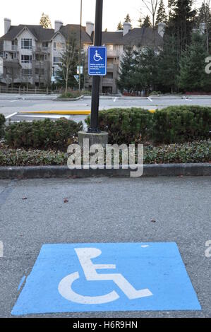 space parking sign home flat apartment road spot street nature wheelchair blue object colour park space traffic - Stock Photo